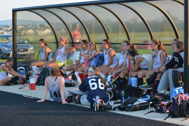 Campers absorb on field action between games