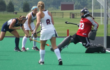 Katelyn Arnold excutes a kick save against Uconn in 2014