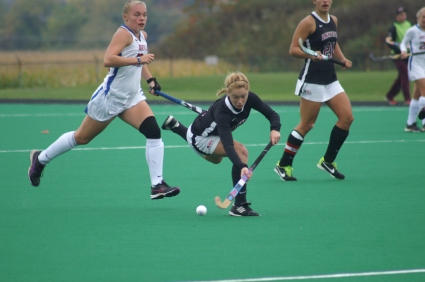 Ami Turner outflanks American University defender in 2014 game