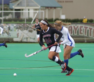 Deanna DeCroce sprints past American University defender