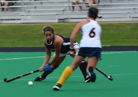 MIllen sends the ball upfield turning back a Bobcat attack
