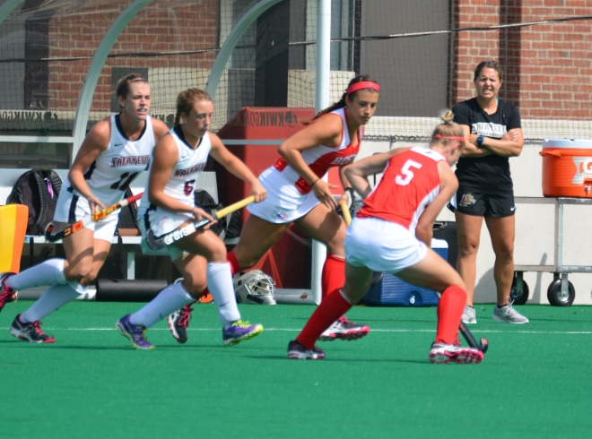 Rosie Shanks and Meg Lillis surround Ellie Landsman of Boston University