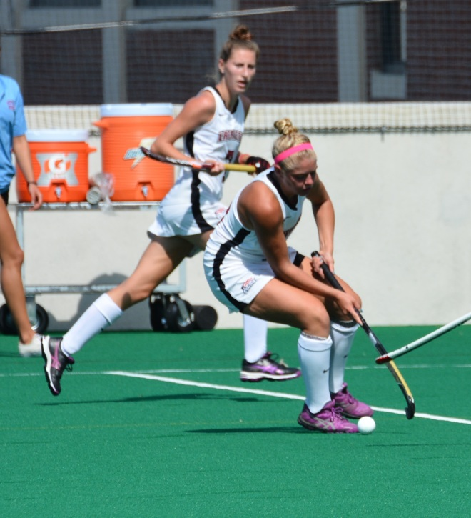 Kirby Szalkowski turns ball around against Boston University