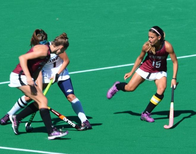 Amanda Magadan and Ellen Colbourne closely guard a UConn player