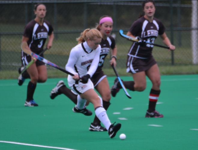Ami Turner gets ahead of a Lehigh defender and passes the ball into the offensive circle