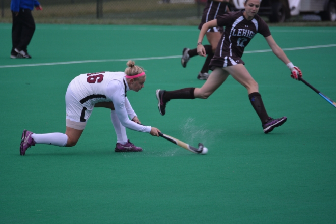 Kirby Szalkowski slips the ball past a Lehigh defender