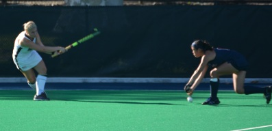 Freshman Rachel Bird hits the ball past a Penn defender