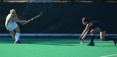 Freshman Rachel Bird hits the ball past a Penn defender