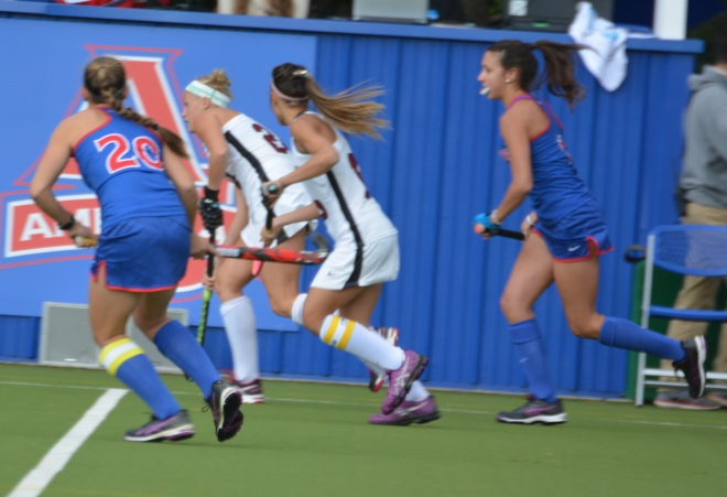 Aliza Furneaux looks downfield as she carries the ball into American's half of the field