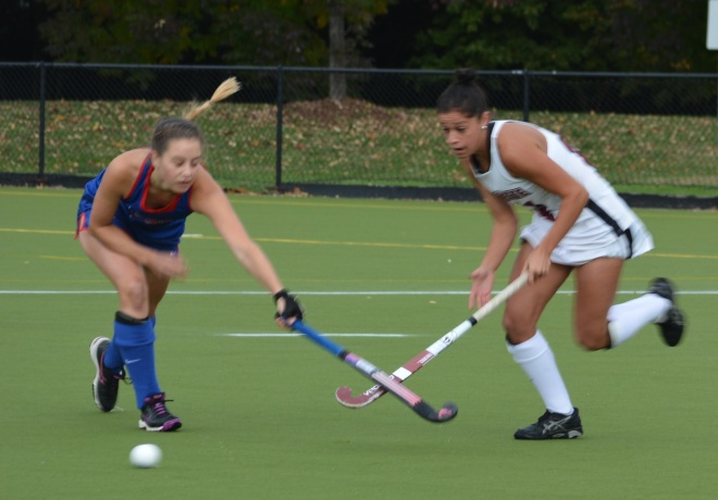 Kendall Weedling's stick gets the attention of an American defender