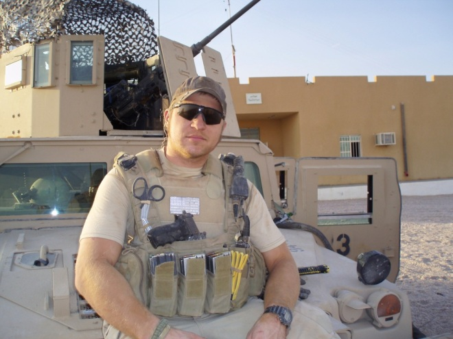 Kevin Lacz in front of humvee in Iraq