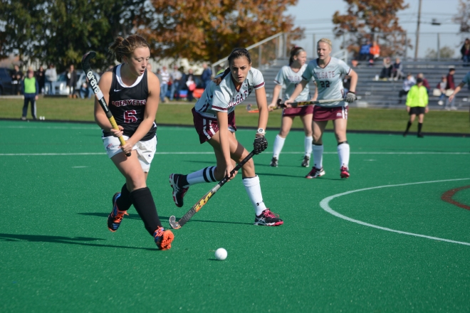 Rosie Shanks attacks the circle in game against Colgate and scores winning goal against Yale