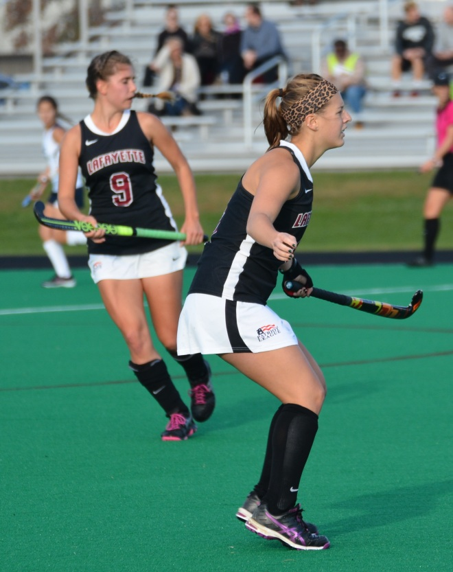 Senior Abby Stefenides gets ready to receive the ball against Yale
