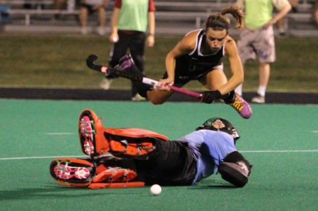 Amanda Magadan takes to the air as the Boston Goalie tries to take her out..the result was a goal