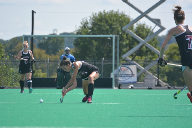 Audrey Sawers powers the ball downfield against Drexel