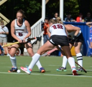 Lisa van der Geest and Rosie Shanks battle for the goal