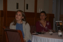 Theresa Delahanty and Liza Welch listening intently to remarks