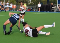 Audrey Sawer continues to fight for possession even as she goes to the turf!!